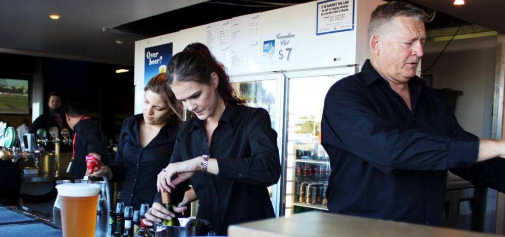Bar staff pouring drinks at Gloucester Park event